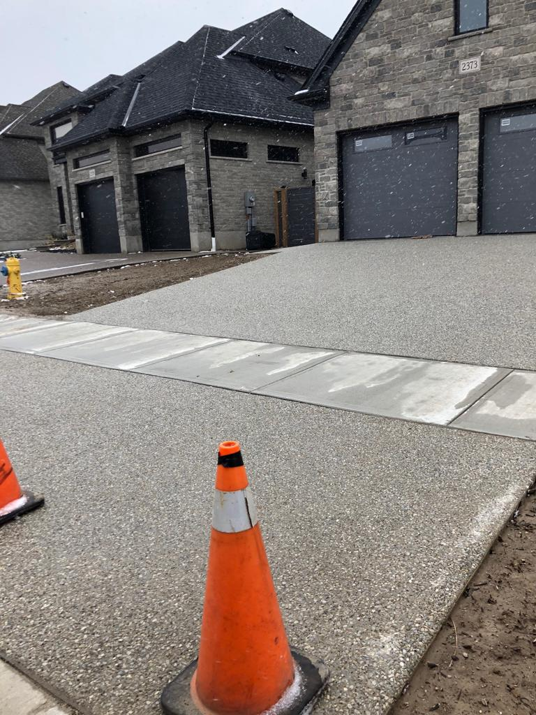 Exposed Aggregate Concreted project in London Ontario or region. Plain or Coloured Exposed Aggregate Concrete Driveways, Walkways, Steps & Patios by Broadway Concrete and Landscaping in London Ontario and region.
